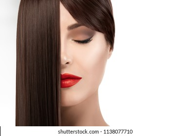 Hair salon concept. Beautiful young woman with gorgeous long brown healthy hair. Keratin Straightening Treatment. Care and hair products.