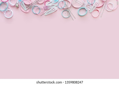 Hair scrunchies and hairpins on pink background, beauty concept, flat lay