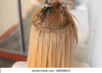 Hair is sewn on a pigtail, hair extensions, blond, blonde, white, strand, tracks