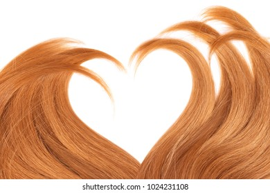 Hair in shape of heart on white background