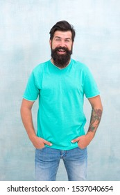 Hair style that suits his face shape. Happy guy with styled hair. Hairy hipster smile with stylish beard and mustache hair. Bearded man smiling with unshaven face hair. Barbershop. Hairdressing salon.