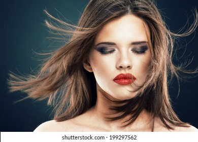 Hair style woman face portrait with closed eyes.  Beauty model with blowing long hair.