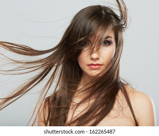 Hair style woman portrait. Female model isolated on white background. Hair in motion.