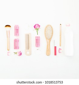 Hair styling concept with tools, curlers and shampoo on white background. Beauty blog. Flat lay, top view