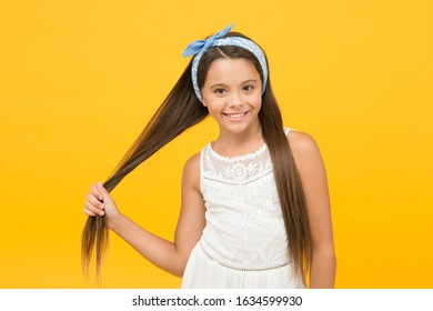Hair styling technique flattening and straightening. Smooth streamlined and sleek appearance. Hair straightening. Adorable little girl perfect long hair. Shampoo and conditioner. Hairdresser salon.