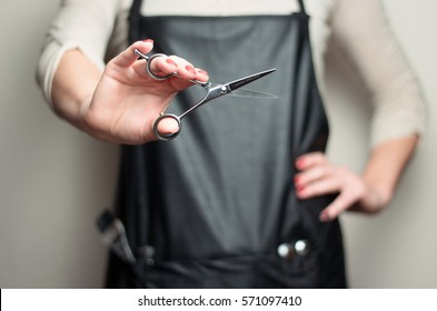 Hair stylist with scissors in hand