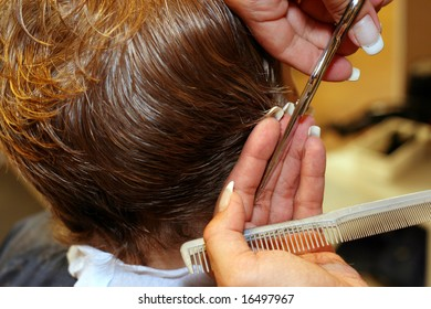 Hair stylist working very fast with her fingers