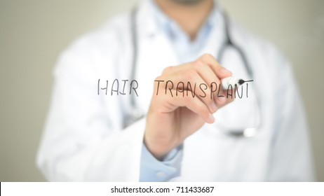 Hair Transplant , Doctor writing on transparent screen