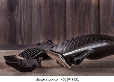 hair trimmer on an old wooden background closeup
