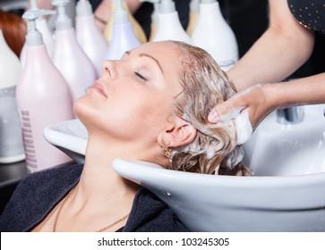 hair washing at a hairdressing salon, young caucasian girl