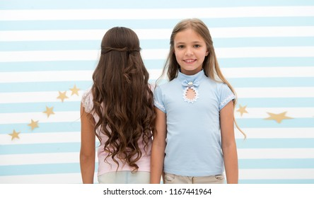 hair wave or perm. hair wave or perm for brunette and blonde small girl. small girl kids at hairdresser. time stops when you looking at them.