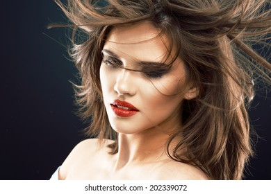 Hair. Woman face. Beauty girl. Blowing hair style.