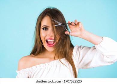 Haircut. Beautiful woman cut her hair. Women's haircut and hairdresser. Bangs hair. Close up hairstyle with bangs