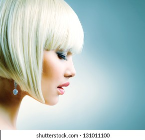 Haircut. Hairstyle. Hairdressing. Fringe. Beautiful Model with Short Blond hair. Bob. Fashion Blonde Girl