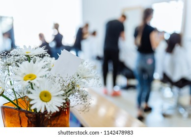 haircut saloon on background. chamomile in vase close up