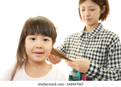 Haircutting girl in the hairdressing saloon