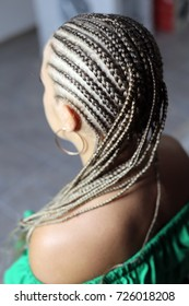 hairdo from artificial hair, curly curls, wavy hair, a shock of hair, the process of braiding African hairstyles, a base of braided plaits for materials of fast weaving, mambotwists, Senegal afro