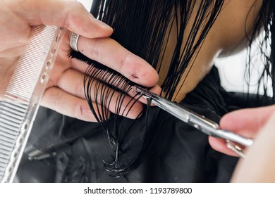 Hairdresser creating a hairstyle for beautiful woman closeup