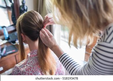 Hairdresser cut girl