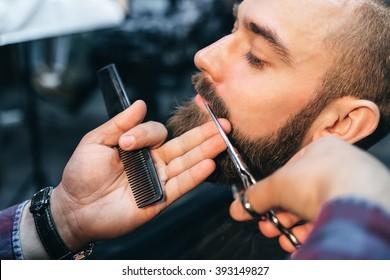 Hairdresser cuts client in Barbershop