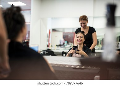 Hairdresser cuts and comb young womans hair