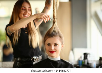 Hairdresser Cutting by Scissors Ponytail Portrait. Woman with Smile Getting Haircut in Beauty Salon. Female with Long Straight Hair Sitting in Studio with Funny Hairstyle Front View Shot.