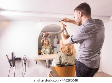 hairdresser cutting hair woman. Motion blur