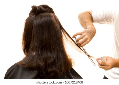 Hairdresser cutting woman hair with scissors isolated in white background