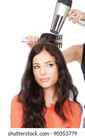 hairdresser is drain a woman's long black hair, isolated on white