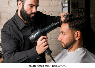 Hairdresser drying a client's hair