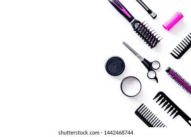 Hairdresser equipment for cutting hair and styling with combs, sciccors, brushes on white background top view copyspace