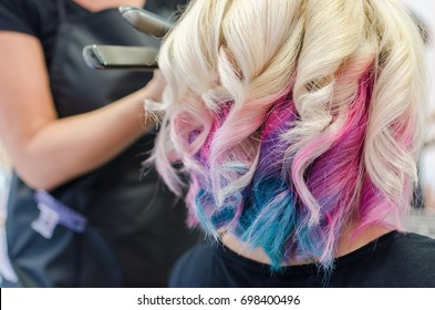 Hairdresser has finished twisting hair and making spiral curl hair style. Unicorn and rainbow haircut. Love my job.