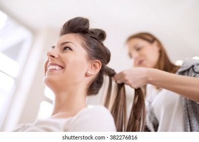 Hairdresser with her customer