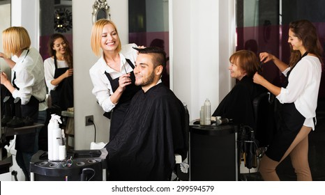 Hairdresser makes the cut for man in the hairdressing salon
