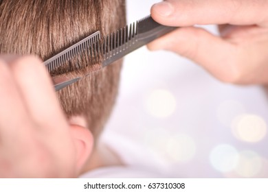 Hairdresser making hairstyle to child.