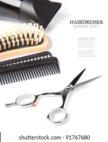 hairdresser scissors,  combs and brush on white background