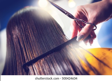 Hairdresser straight hair with comb. Colorized