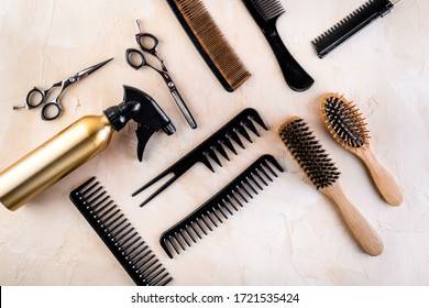 Hairdresser tools. Flat lay on beige background top view