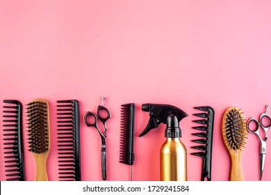 Hairdresser tools. Flat lay on pink background top view space for text