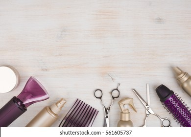 Hairdresser tools on wooden background with copy space at top.