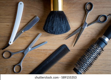 Hairdresser tools on a wooden background