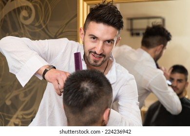 Hairdresser Trimming Black Hair With Scissors - Handsome Young Hairdresser Giving A New Haircut To Male Customer At Parlor