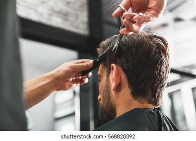 Hairdresser undergoing hairdo at salon