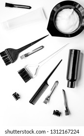 hairdresser woorking desk with tools on white background top view