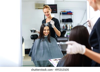 hairdresser working in front of a mirror