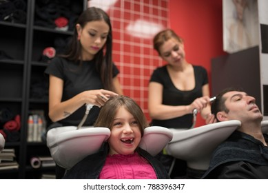 Hairdressers with little girls and man. Father and daughter at hairdresser