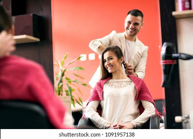 At the hairdresser's, smiling woman getting her hair done in the beauty salon