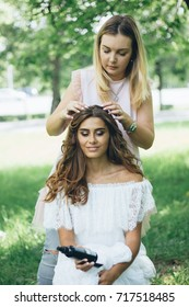 Hairdressing, Master create beautiful hairstyle for young woman