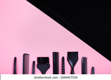 Hairdressing tools with copy space, combs and bleach brushes on pastel colored paper background, top view and flat lay