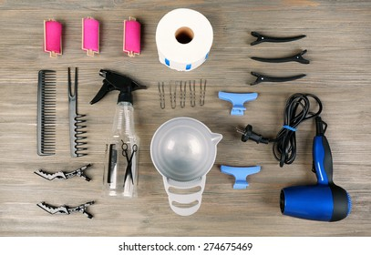 Hairdressing tools on wooden background
